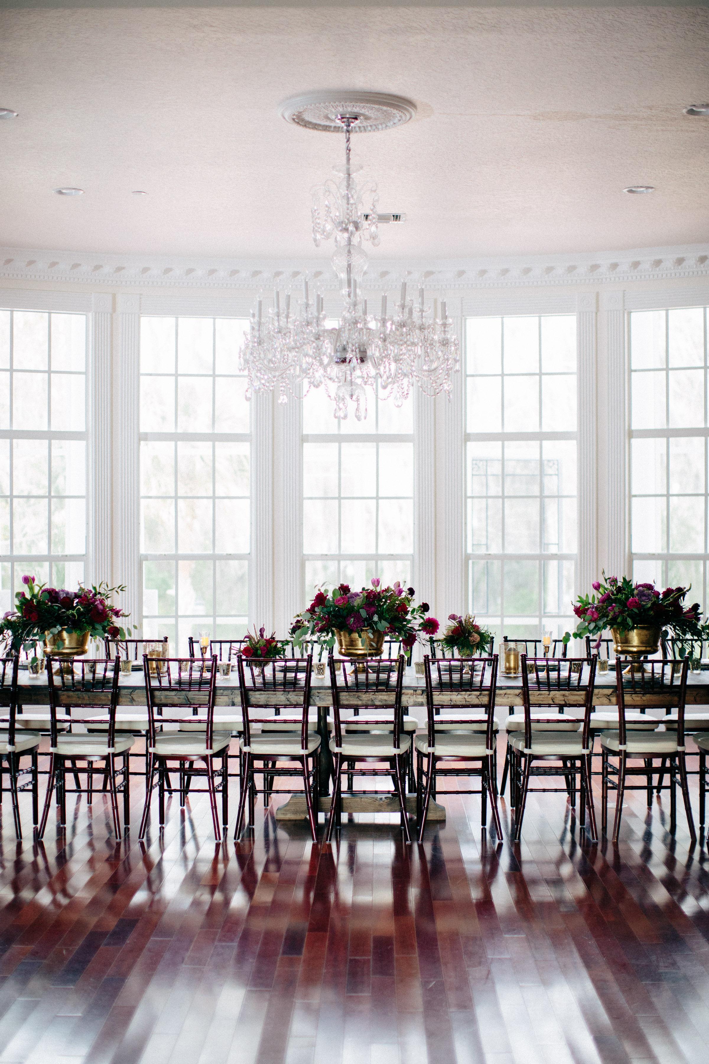 Estate Wedding, Ballroom Reception, Chandelier, farm table, farm table, RW Events, Vintage Rentals, orlando vintage rentals, ballroom wedding, mahogany chiavari chairs, luxury wedding, farm tables, head table