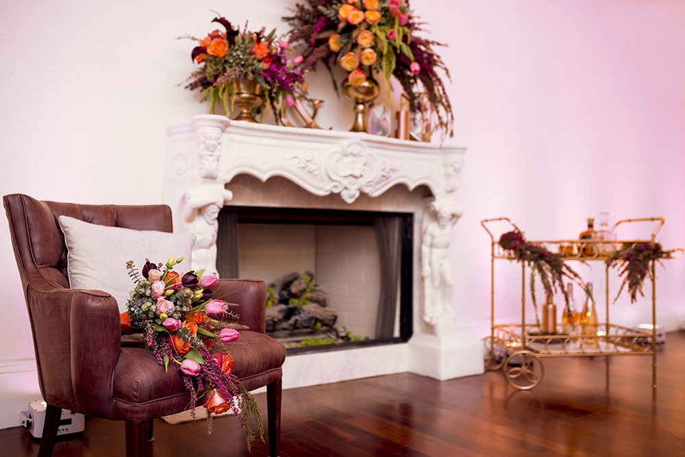 RW Events, Orlando Wedding Stylist, Orlando Wedding Designer, Vintage Rentals, Orlando Vintage Rentals, Luxmore Grande Estate, Fireplace, Wedding Floral, Fall Wedding, Leather Tufted Armchair, Gold Bar Cart, Orange Wedding Floral, Pink Wedding Floral, Burgundy Wedding Floral, Gold Wedding Decor
