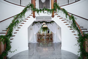 grand staircase, twin staircase, Orlando luxury wedding venue, indoor venue, greenery decor, orlando wedding venues, central florida wedding venues, luxury wedding