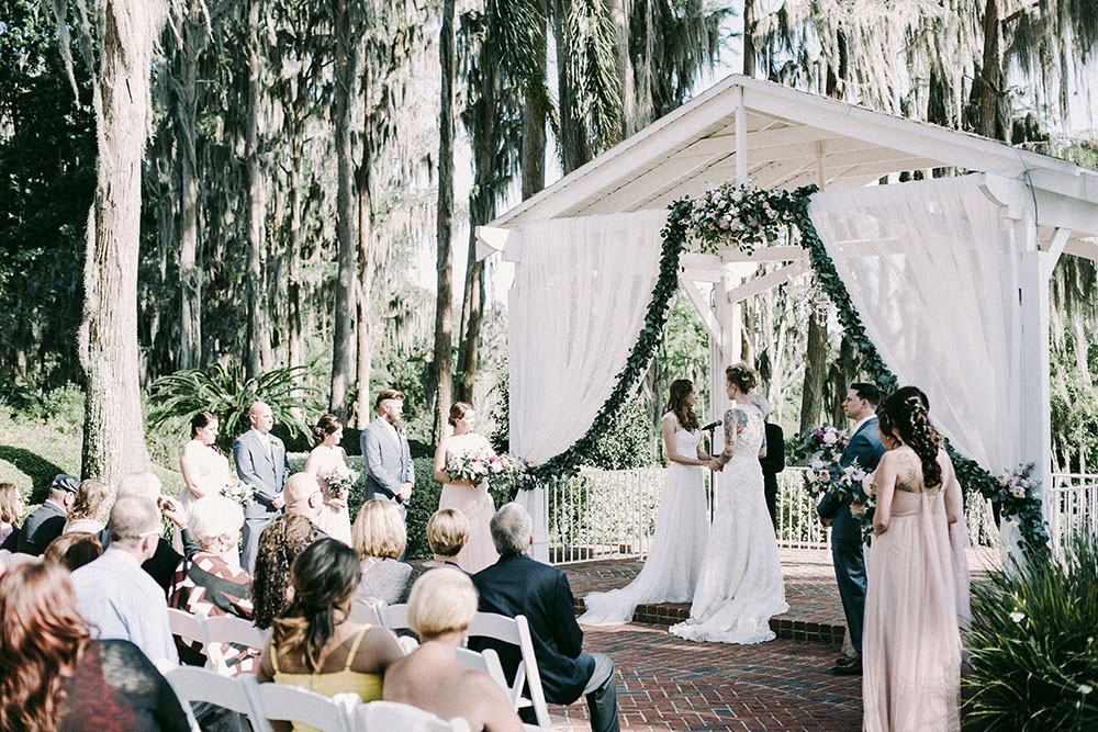 Cypress Grove Estate House, Orlando Wedding Venues, Central Florida Wedding Venues, Lakeside Wedding, Outdoor Wedding, Southern Wedding, Rustic Wedding, Cypress Trees, Spanish Moss, White Ceremony Draping, Gazebo Draping, Bridal Photos, Light Pink Bridesmaid Dresses, Garland, White Ceremony Chairs