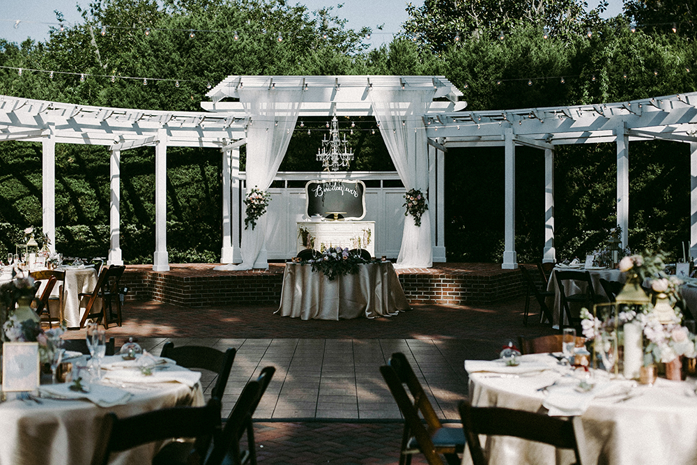 Cypress Grove Estate House, Outdoor Wedding, Lakeside Wedding, Central Florida Wedding Venues, Orlando Wedding Venues, French Country Chairs, ivory dupioni linen, over the top linen, gold lanterns, gold rimmed chargers, glass chargers, mahogany resin chairs, cake display, rw events, orlando wedding stylist, orlando wedding designer, orlando vintage rentals, white reception draping, chandelier
