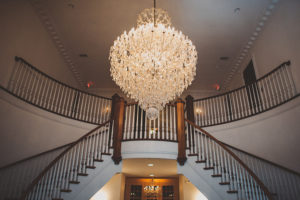 Grand Chandelier, orlando Luxury wedding, central florida luxury wedding, indoor reception, twin staircase, grand staircase,