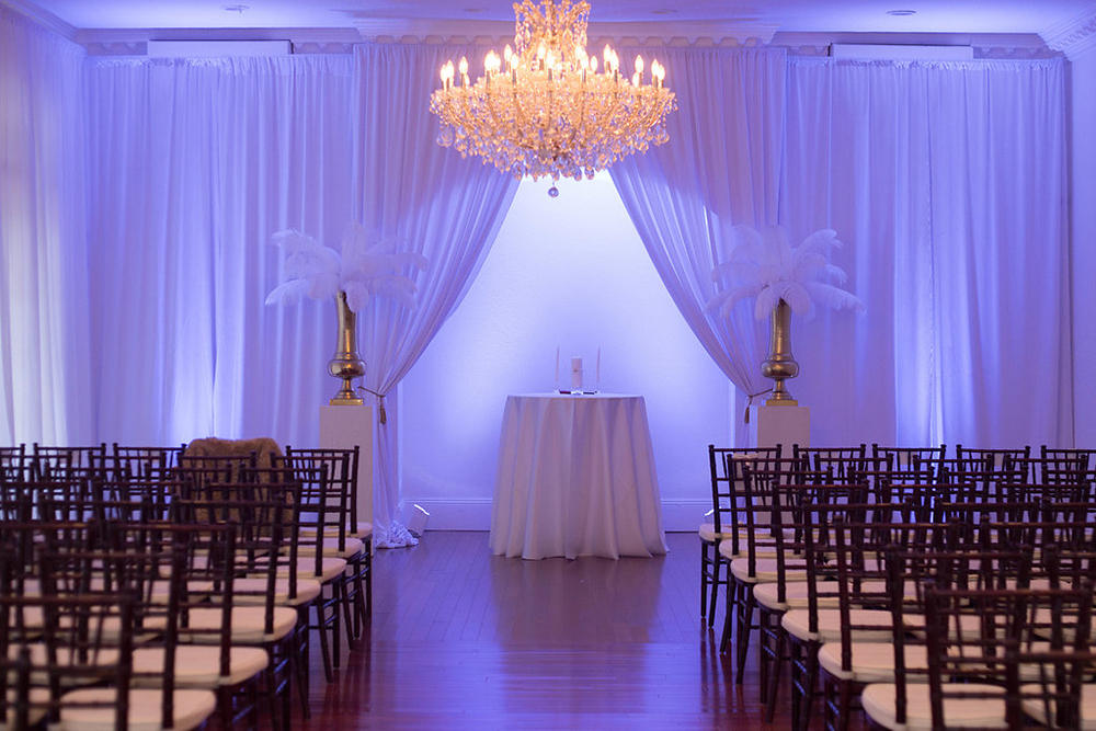 ceremony draping, indoor ceremony, luxury wedding, luxmore wedding, uplights, feather ceremony decor, gold ceremony decor, ballroom wedding, central florida wedding venues, unity candle, luxury orlando wedding,