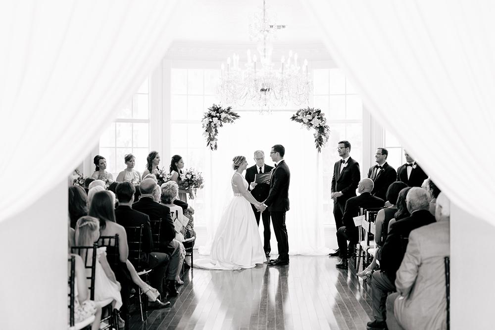 Orlando Ballroom wedding, elegant ceremony draping, draped ceremony arch, luxury ballroom wedding, central florida ballroom wedding, bride and groom