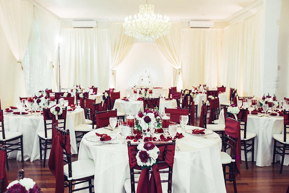 Ballroom reception, luxury wedding, orlando wedding venue, ballroom draping, chandelier, ballroom wedding, princess bridal gown, uplighting, hardwood floors, mahogany chiavari chairs,