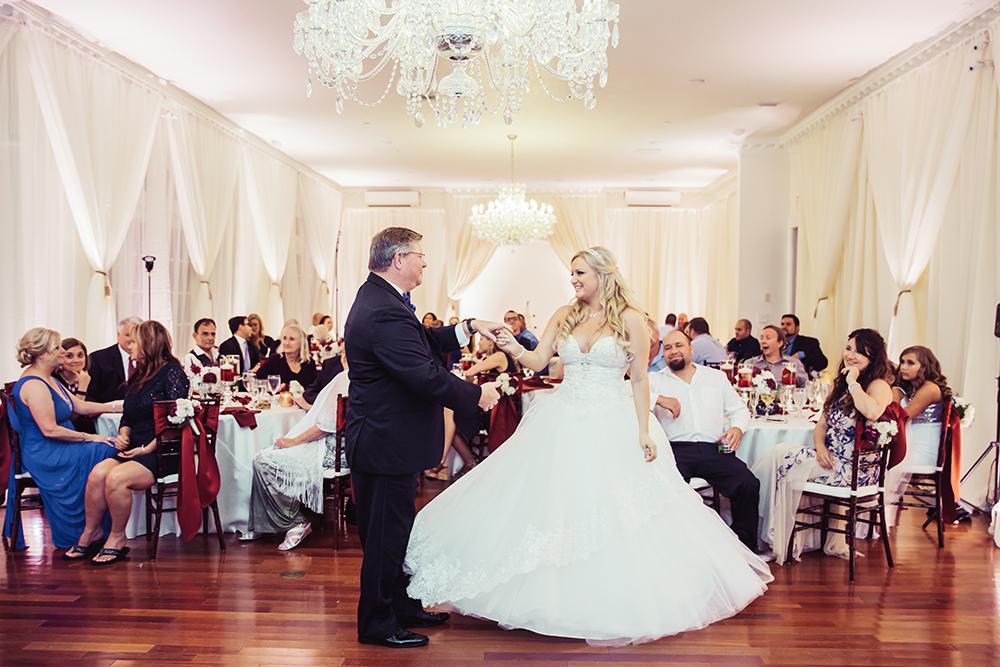 Ballroom reception, luxury wedding, orlando wedding venue, ballroom draping, chandelier, ballroom wedding, princess bridal gown, uplighting, hardwood floors, mahogany chiavari chairs, father daughter dance,