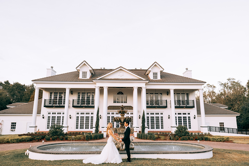 orlando wedding venue, luxury wedding venue, estate wedding, indoor wedding venue, ballroom wedding, luxmore grande estate, bride and groom photos, private estate wedding, fountain