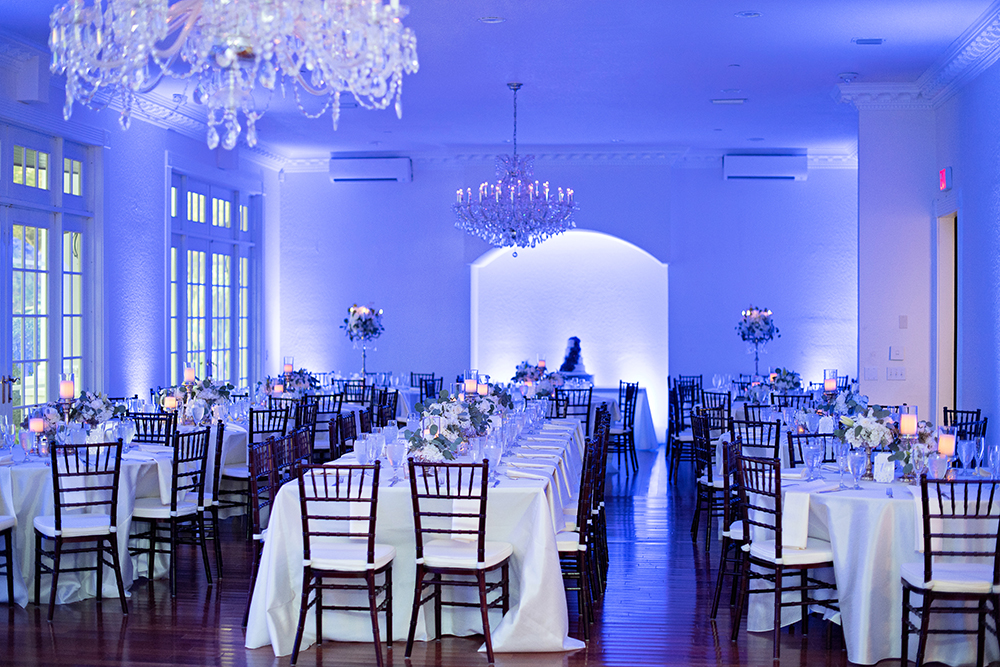 ballroom reception, orlando luxury reception, indoor wedding venue, mahogany chiavari chairs, white uplights, chandeliers, fairytale wedding, feasting tables, central florida wedding venues, ballroom wedding, candelabra centerpieces, white wedding flowers, ivory dupioni linen