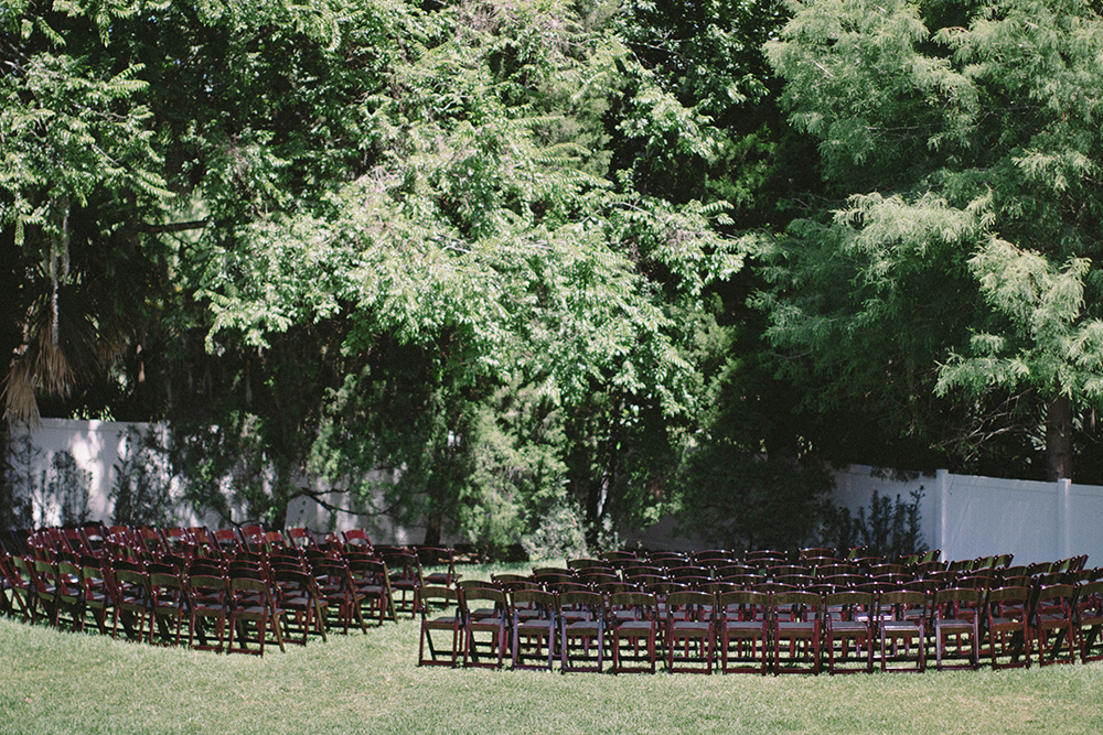Orlando garden ceremony, Orlando outdoor venue, central florida wedding venue, mahogany garden chairs, symmetrical ceremony chairs, curved seating, semi-circle ceremony