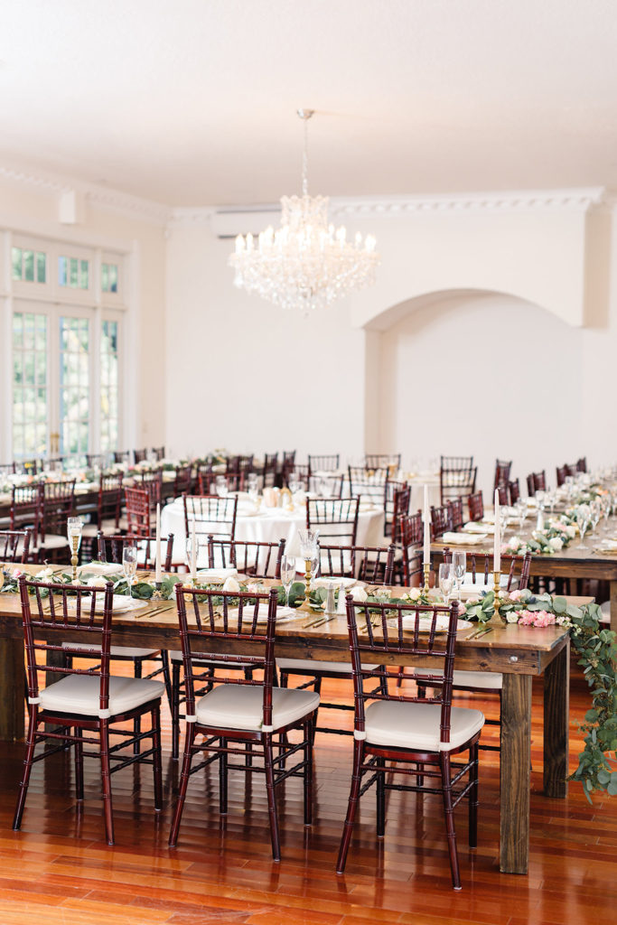 Ballroom reception, indoor venue, mahogany chiavari chairs, ivory wedding decor, luxmore grande estate, central florida wedding venues, orlando wedding venues, ballroom wedding, farm tables, rw events, orlando vintage rentals, orlando wedding designer, orlando wedding stylist, feasting tables