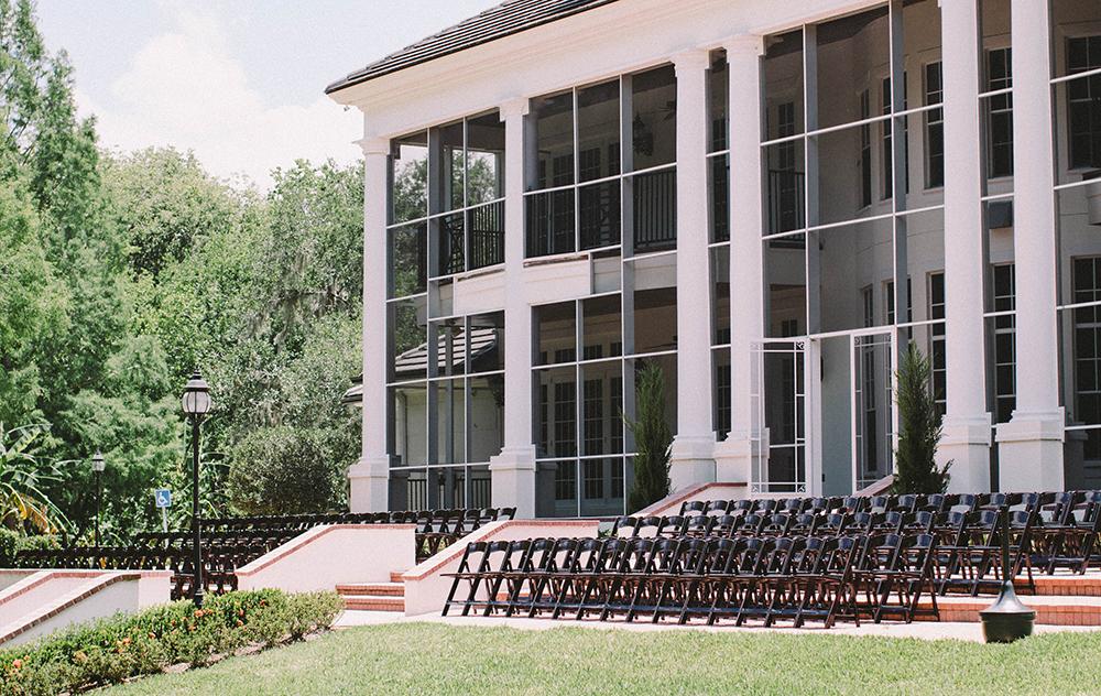luxmore grande estate, patio ceremony, Orlando outdoor venue, mahogany garden chairs, central florida wedding venue