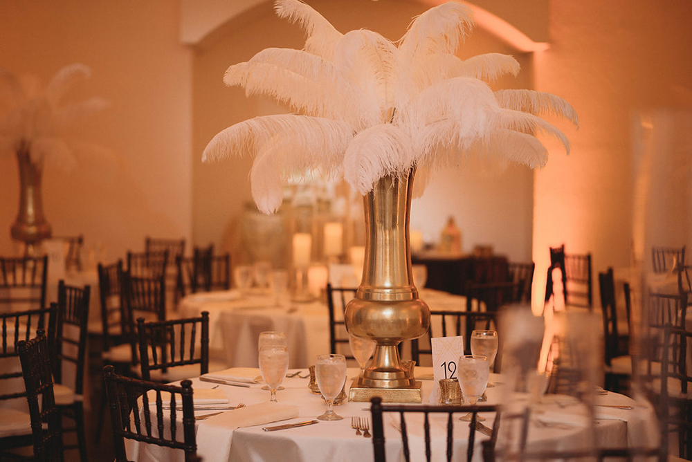 luxury venue, ballroom reception, all white decor, gold and white reception, feather centerpiece, mahogany chiavari chair