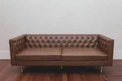 brown tufted sofa rental in orlando for bohemian and corporate events