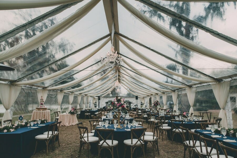 This tent! Clear top, ivory draping, and chandeliers make this tent absolutely stunning, and a not-so-bad alternative.