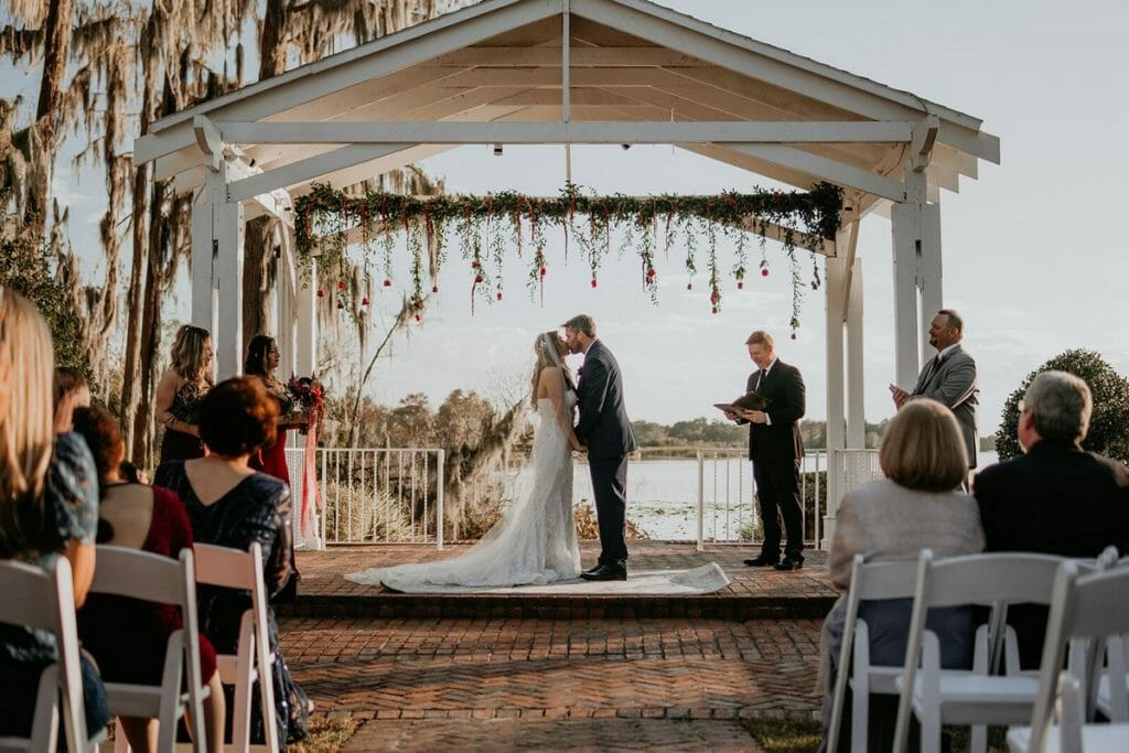 The Cypress Grove Estate House gazebo adorned with hanging floral.