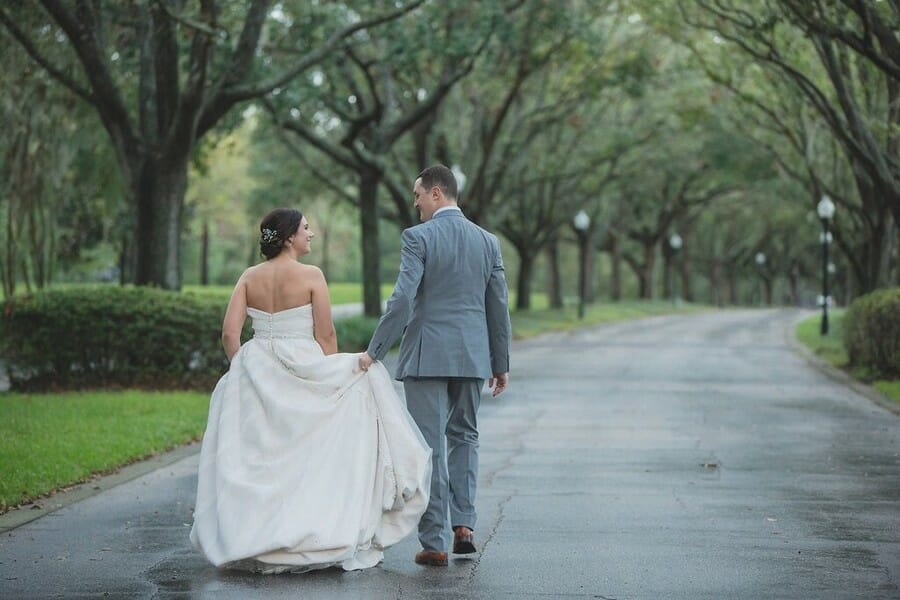 Even on rainy days, the tree lined drive at Cypress Grove Estate House still makes a stunning backdrop for couple's photos!