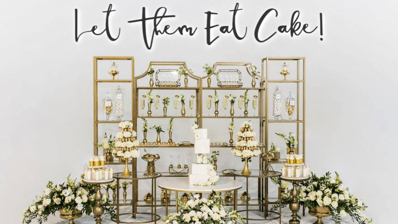White Wedding Cake Vignette Featuring Gold Accent Tables, Gold Shelves, and Lush Floral.