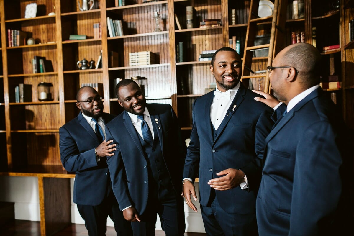 A classic color for groomsmen attire, navy looks great on all the guys!