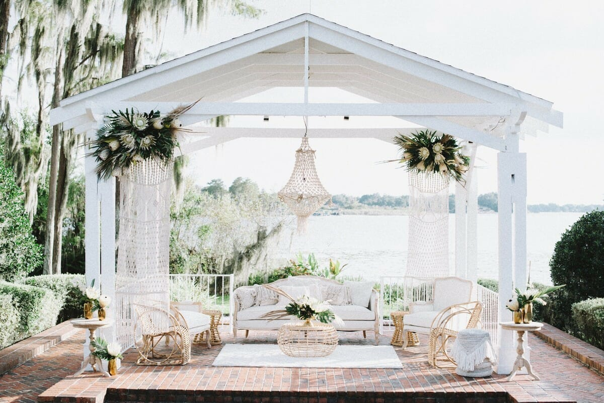 Tropical wedding foliage used to adorn the gazebo at Cypress Grove Estate House