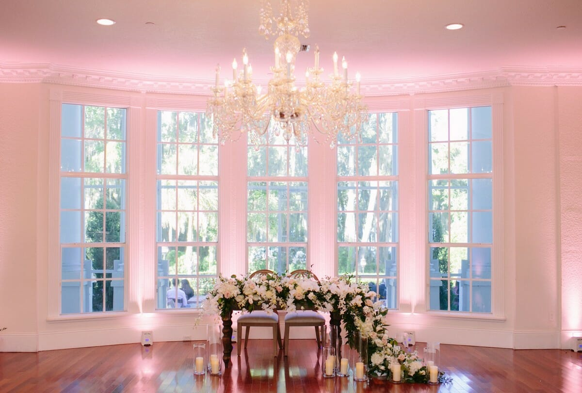 Lighting | The couple chose a light pink uplight to accent their sweetheart table.