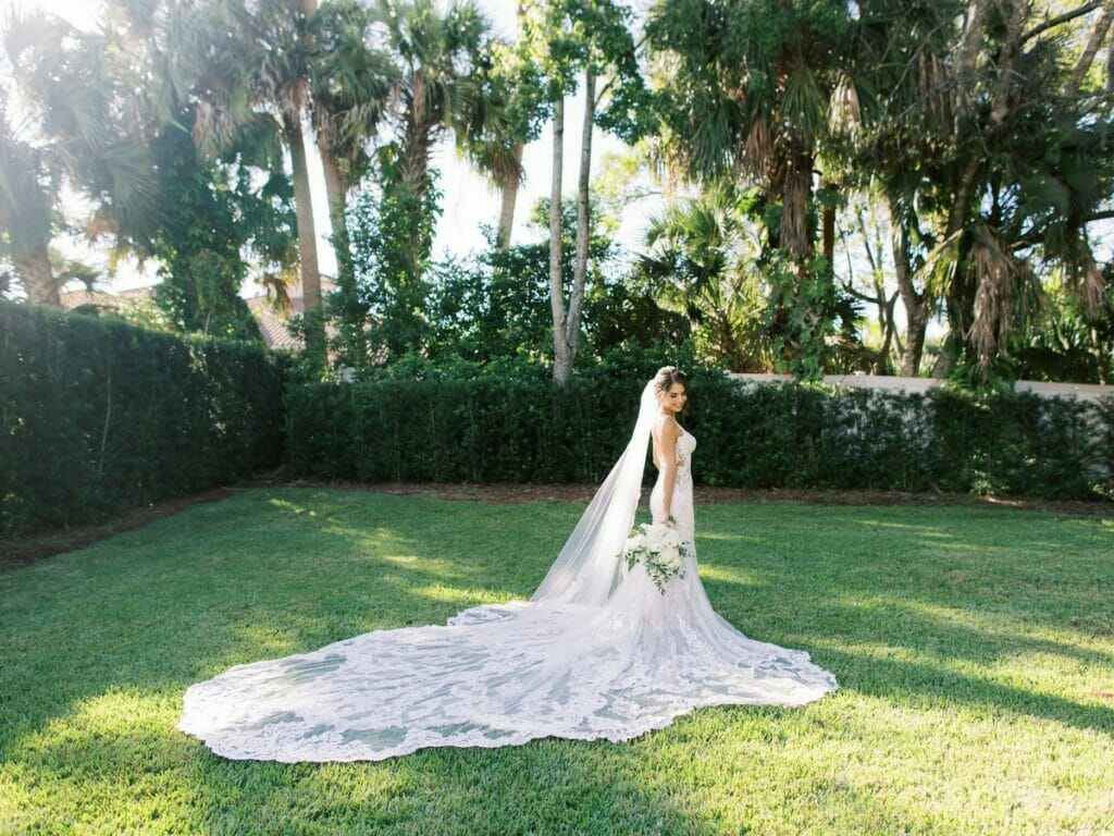 Bridal Portraits | The bride posing with her bouquet on the lawn at Luxmore Grande Estate.