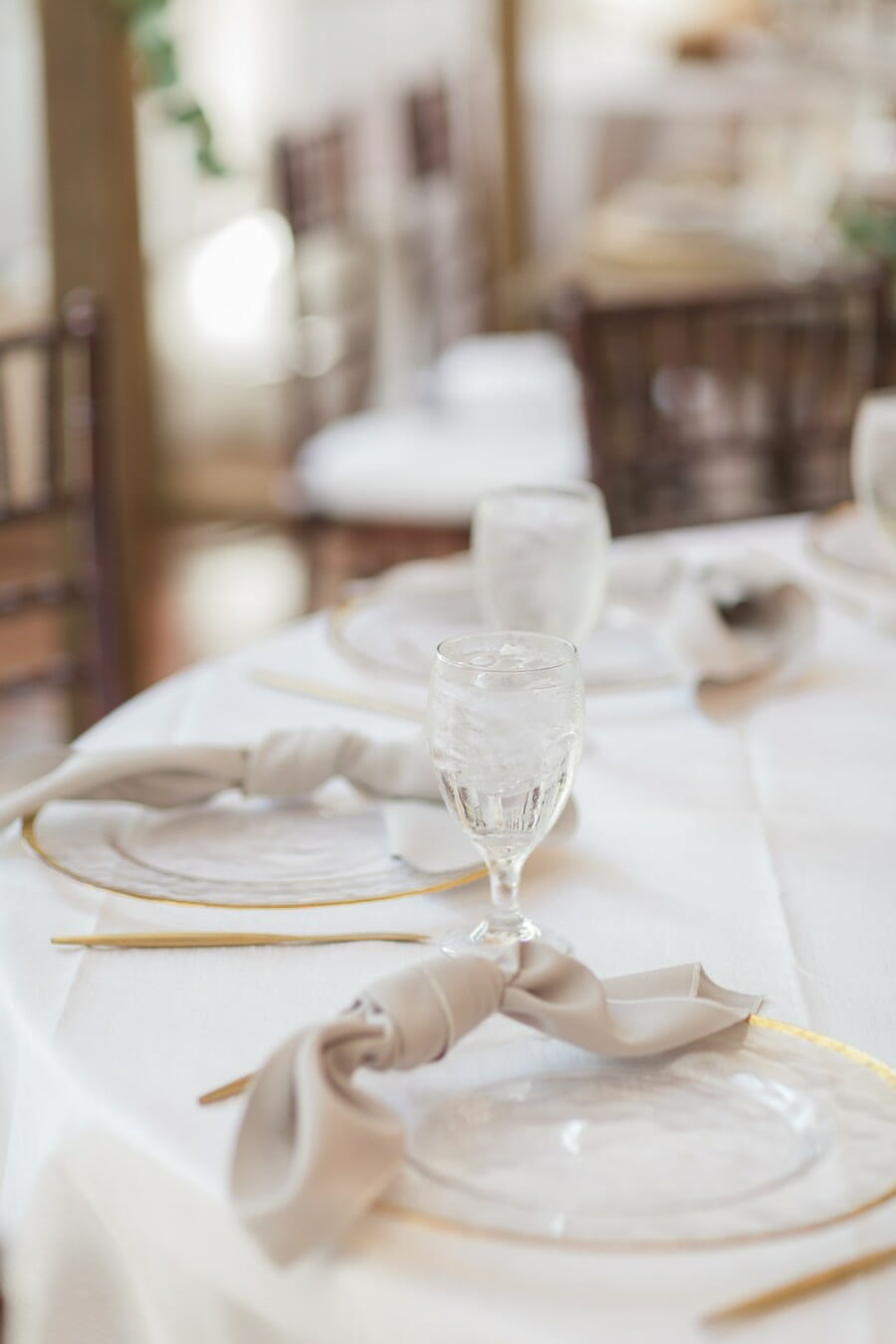 Gold Rimmed Chargers & Neutral Napkin